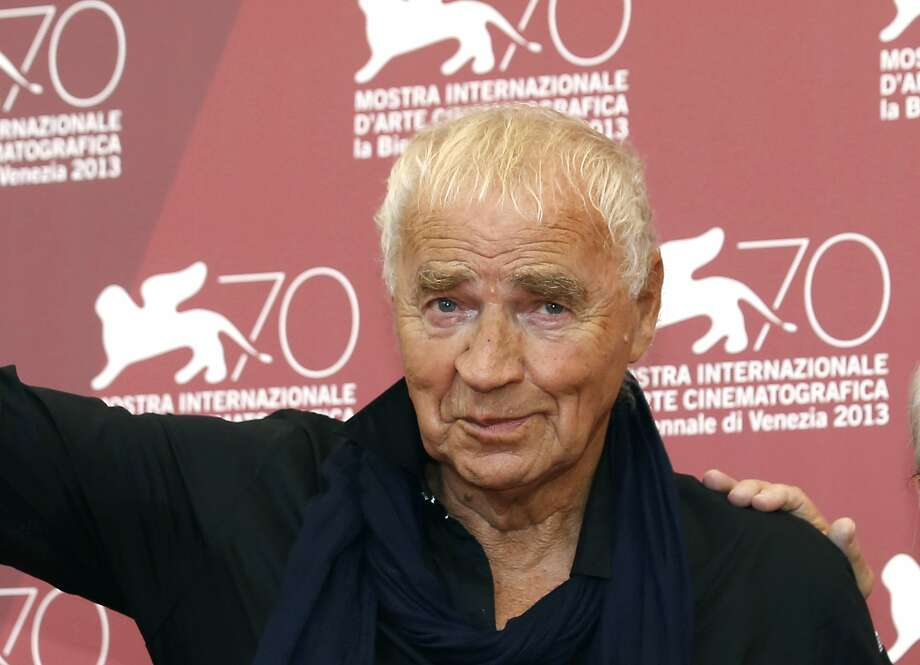 """FILE - In this Thursday, Sept. 5, 2013 file photo, writer Janusz Glowacki poses for photographers with director Andrzej Wajda, during the photo call for the film Walesa. Man Of Hope, at the Venice Film Festival in Venice, Italy. The wife of renowned Polish-U.S. playwright and screenwriter Janusz Glowacki says he has died at 78, it was reported on Saturday, Aug. 19, 2017. Popular in New York and Polish artistic and intellectual circles, Glowacki was the author of award-winning plays """"Antigone in New York"""" and """"The Fourth Sister,"""" which set classic themes in the contemporary world. (AP Photo/David Azia, File) Photo: David Azia, Associated Press"""
