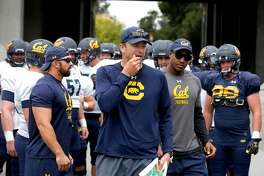 First year head coach Justin Wilcox leads the Cal Bears football team onto the field for a practice and scrimmage in Memorial Stadium at UC Berkeley on Saturday, Aug. 19, 2017.