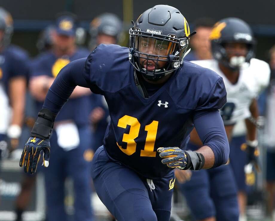 Linebacker Raymond Davison III chases down the ball carrier during a Cal Bears football practice and scrimmage in Memorial Stadium at UC Berkeley on Saturday, Aug. 19, 2017. Photo: Paul Chinn, The Chronicle