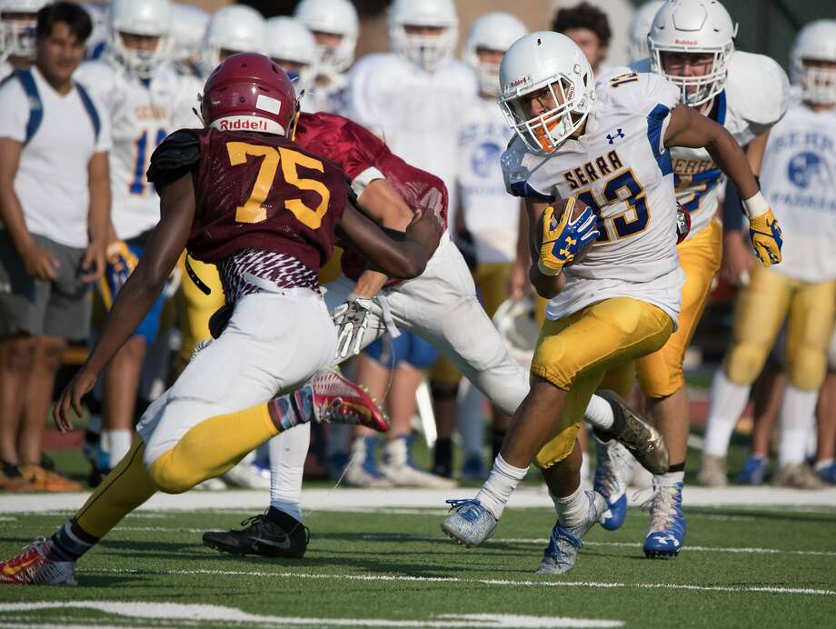 Serra's Isiah Kendrick runs past Nick Anderson from Menlo-Atherton during a three-way scrimmage. Photo: Paul Kuroda, Special To The Chronicle
