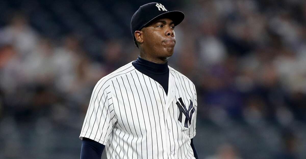 NEW YORK, NY - AUGUST 15: Aroldis Chapman #54 of the New York Yankees reacts in the ninth inning against the New York Mets during interleague play on August 15, 2017 at Yankee Stadium in the Bronx borough of New York City. (Photo by Elsa/Getty Images)