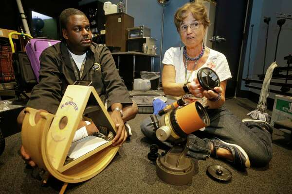 James Wooten, planetarium astronomer, left, and Dr. Carolyn Sumners, vice president of astronomy & physics, talk at Museum of Natural Science, 5555 Hermann Park, about the trip they are leading to Casper Wyoming for the solar eclipse shown Wednesday, Aug. 16, 2017, in Houston. Dr. Carolyn Sumners used the same telescope to view an eclipse in Winnipeg in 1979.  ( Melissa Phillip / Houston Chronicle )
