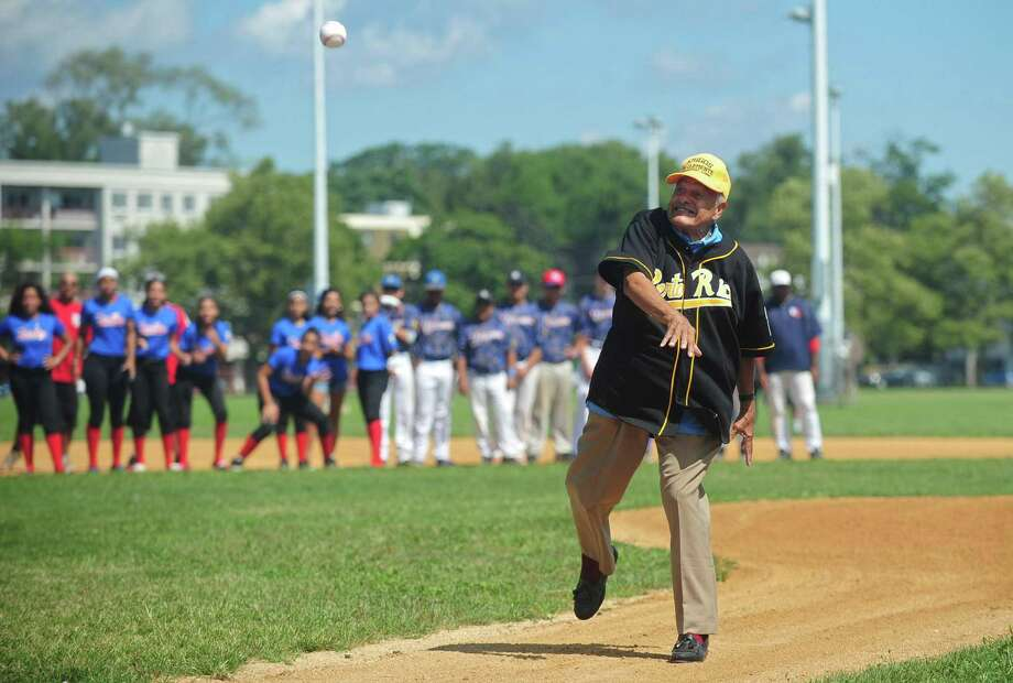 Friends of Clemente Committee member Noberto Medina throws out the first pitch during The Caribe Baseball/Softball's annual Roberto Clemente Day ceremony at Seaside Park Saturday, August 19, 2017, in Bridgeport, Conn. Photo: Erik Trautmann / Hearst Connecticut Media / Norwalk Hour