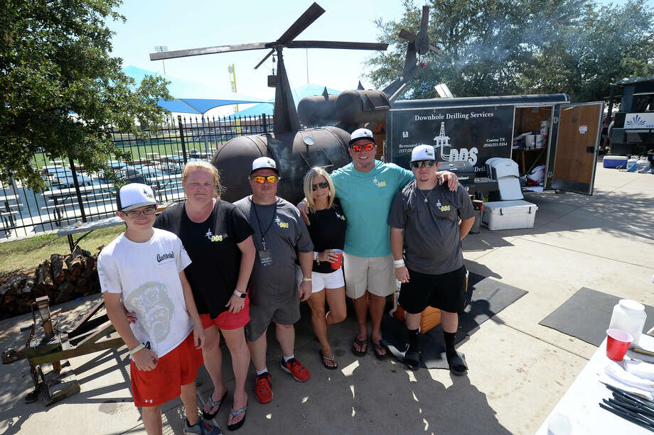 The Downhole Drilling Services crew poses for a photo with their helicopter shaped smoker during the Basin Burnout fundraiser for Reel Thanx and Hunt for Heroes, featuring a barbecue cook-off, kids activities, and music, Aug. 19, 2017, at the Scharbauer Sports Complex. James Durbin/Reporter-Telegram Photo: James Durbin