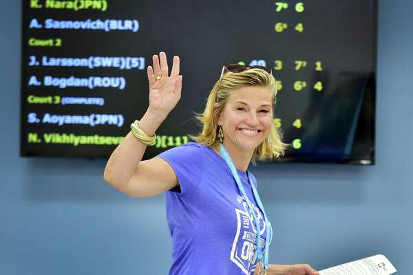 (Peter Hvizdak / Hearst Connecticut Media) New Haven,Connecticut: Saturday, August 19, 2017. Connecticut Open tournament director Anne Worcester waves to a photographer Saturday afternoon in the Media Center at the Connecticut Open tennis tournament.