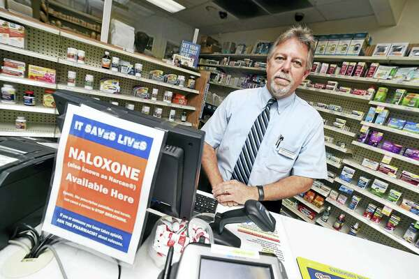Ed Funaro Jr., director of Visels Pharmacy, behind the counter at his 714 Dixwell Ave., New Haven, pharmacy.