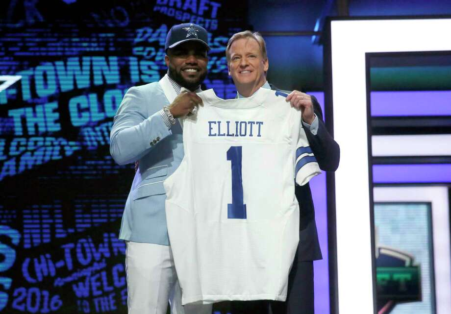Ezekiel Elliott, left, and NFL commissioner Roger Goodell poised in harmony a year ago after the Cowboys drafted the running back. But Goodell has now slapped a six-game suspension on him. Photo: Charles Rex Arbogast, STF / Copyright 2017 The Associated Press. All rights reserved.