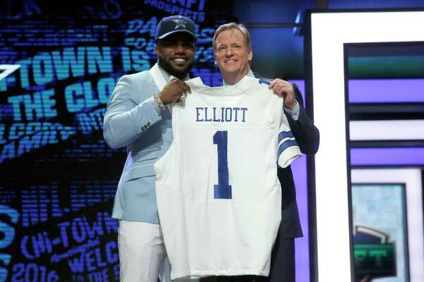 Ezekiel Elliott, left, and NFL commissioner Roger Goodell poised in harmony a year ago after the Cowboys drafted the running back. But Goodell has now slapped a six-game suspension on him.