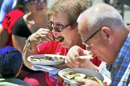 (Peter Hvizdak / Hearst Connecticut Media)   Milford, Connecticut: Saturday, August 19, 2017. Jacqueline Swanson and her husband Roger, of Southington  eat oysters together Saturday afternoon during their first visit to the Milford Oyster Festival in Milford.