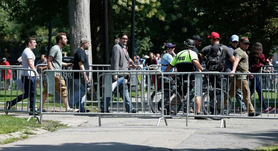 "Organizers depart a ""Free Speech"" rally staged by conservative activists on Boston Common, Saturday, Aug. 19, 2017, in Boston.  One of the planned speakers of a conservative activist rally that appeared to end shortly after it began says the event ""fell apart."" Dozens of rallygoers gathered Saturday on Boston Common, but then left less than an hour after the event was getting underway. Thousands of counterprotesters had also gathered. (AP Photo/Michael Dwyer) Photo: Michael Dwyer, STF / Copyright 2017 The Associated Press. All rights reserved."