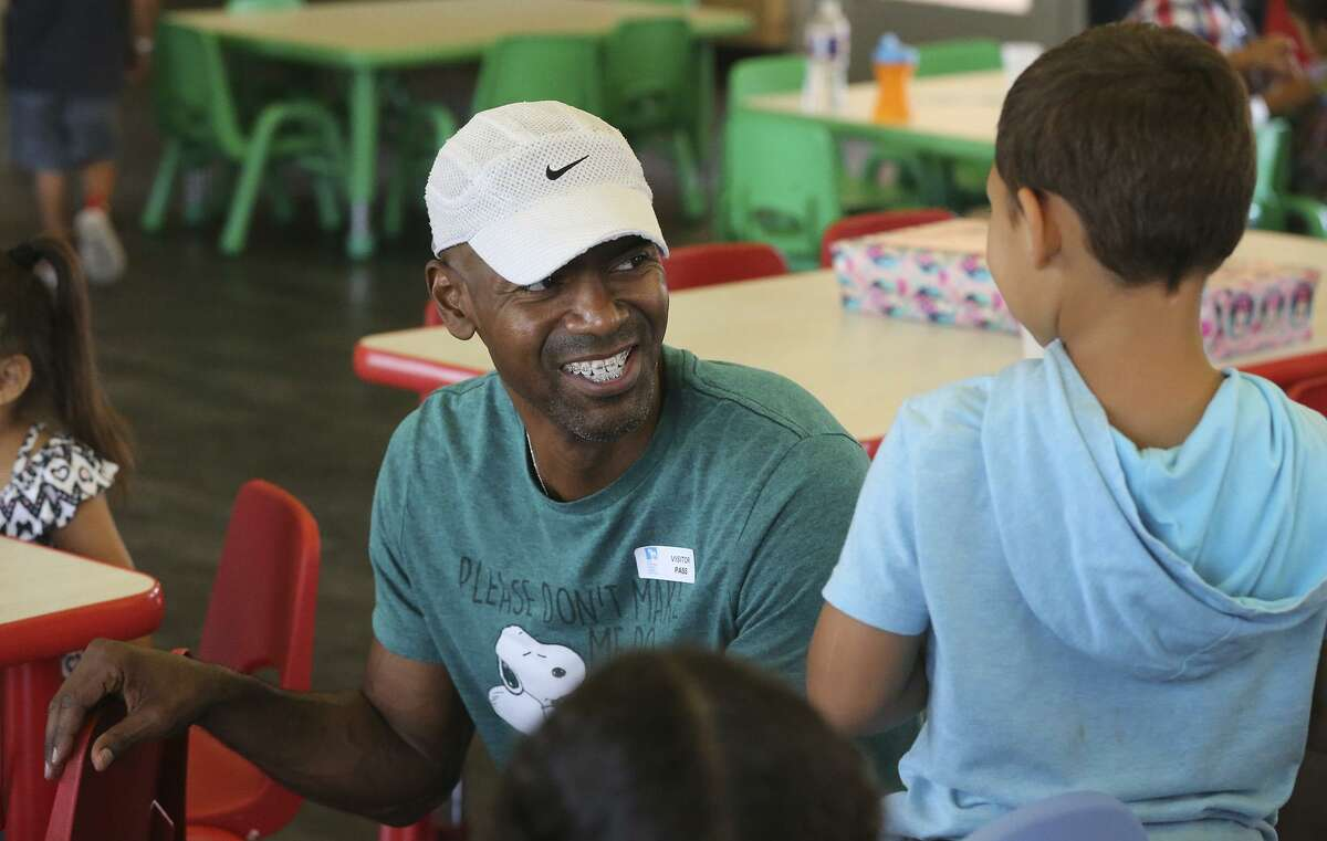 """Kortney Johnson (center) volunteers at The Children's Center Tuesday August 8, 2017. Johnson has been in the U.S. Army for the past 23 years and helps kids at the center celebrate their birthdays. """"It's our obligation to help one another,"""" Johnson said."""