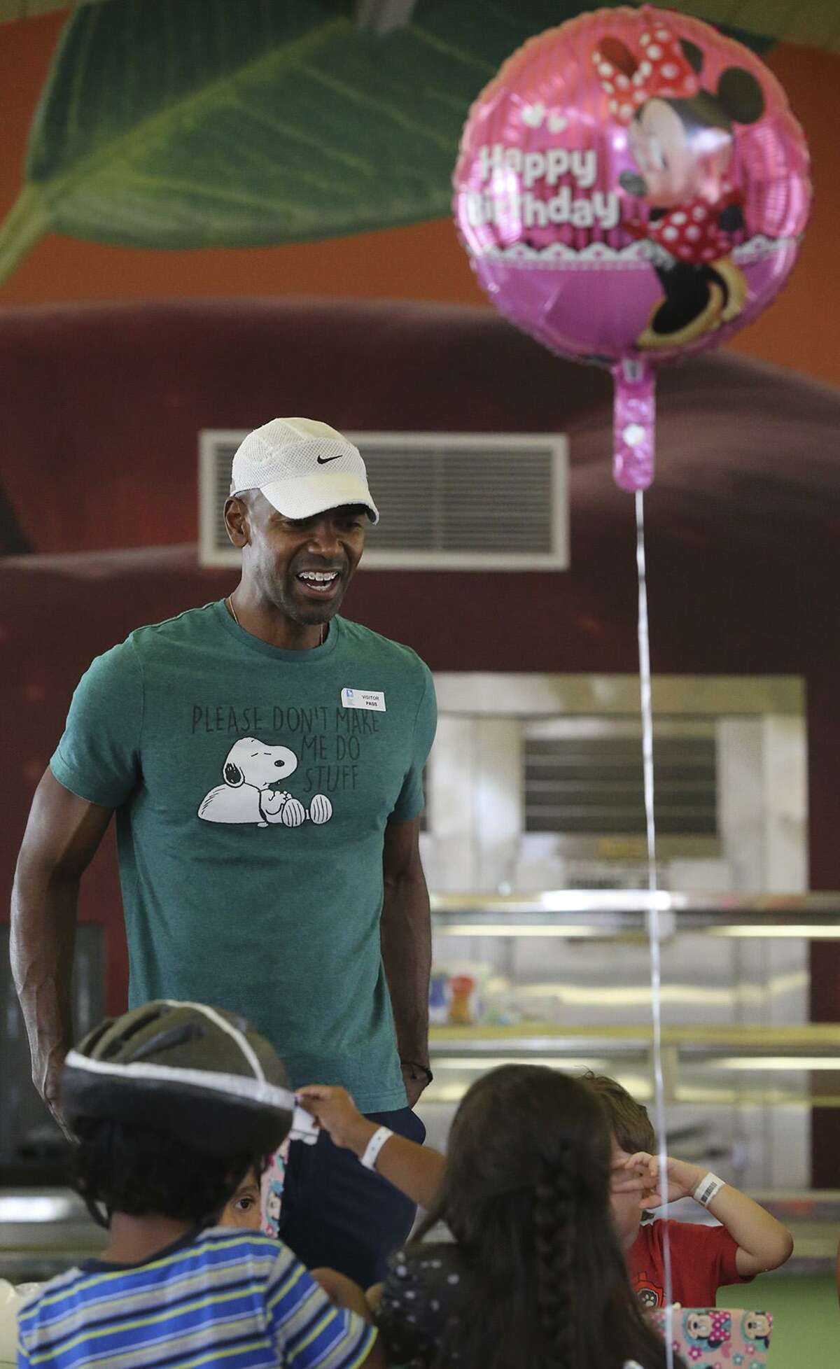 """Kortney Johnson (facing, wearing cap) volunteers at The Children's Center Tuesday August 8, 2017. Johnson has been in the U.S. Army for the past 23 years and helps kids at the center celebrate their birthdays. """"It's our obligation to help one another,"""" Johnson said."""
