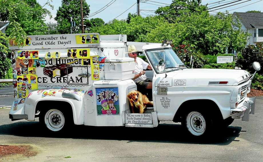 "(Peter Hvizdak - New Haven Register) Good Humor man Joseph ""Papa Joe"" Barbato of Madison and his trusty dog Bailey traveling to their next ice cream selling stop in Madison Tuesday July 14, 2015. / ©2015 Peter Hvizdak"
