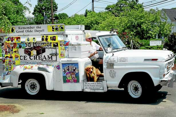 "(Peter Hvizdak - New Haven Register) Good Humor man Joseph ""Papa Joe"" Barbato of Madison and his trusty dog Bailey traveling to their next ice cream selling stop in Madison Tuesday July 14, 2015."