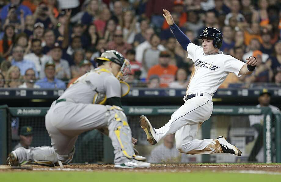 HOUSTON, TX - AUGUST 19: Alex Bregman #2 of the Houston Astros slides home against Bruce Maxwell #13 of the Oakland Athletics in the fifth inning at Minute Maid Park on August 19, 2017 in Houston, Texas. Bregman was called out on the play . (Photo by Thomas B. Shea/Getty Images) Photo: Thomas B. Shea, Getty Images
