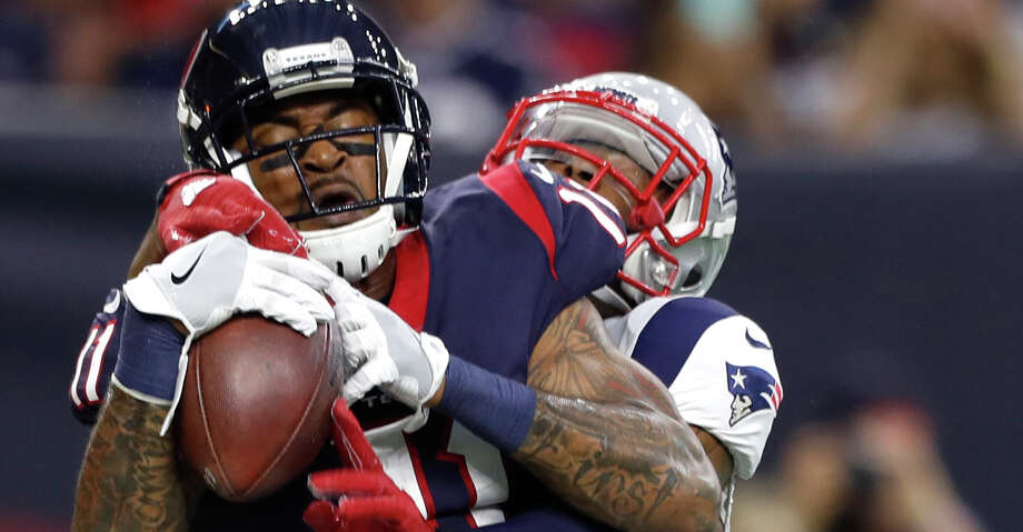 Houston Texans wide receiver Jaelen Strong (11) comes down with a 2-yard touchdown reception against New England Patriots cornerback Malcolm Butler (21) during the first quarter of an NFL preseason game at NRG Stadium, Saturday, Aug. 19, 2017, in Houston.  ( Karen Warren / Houston Chronicle ) Photo: Karen Warren/Houston Chronicle