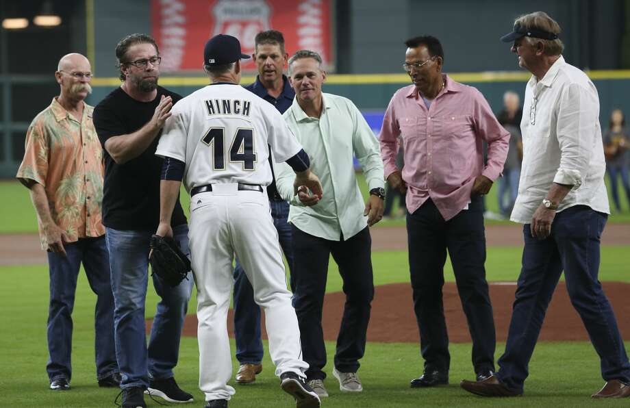 Houston Astros manager A.J. Hinch (14) shakes hands with the representatives from the 1997 Houston Astros team before the Houston Astros takes on Oakland Athletics at Minute Maid Park Saturday, Aug. 19, 2017, in Houston. ( Yi-Chin Lee / Houston Chronicle ) Photo: Yi-Chin Lee/Houston Chronicle