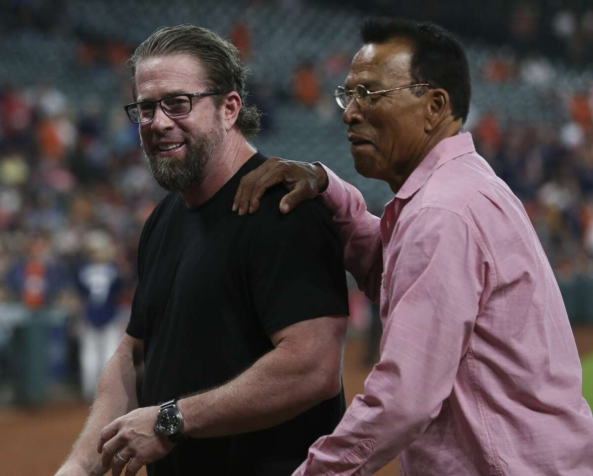 Former Astros and National Baseball Hall of Famer Jeff Bagwell, left, and former Astros Jose Cruz walk off the field after the first pitch ceremony before Houston Astros takes on Oakland Athletics at Minute Maid Park Saturday, Aug. 19, 2017, in Houston. ( Yi-Chin Lee / Houston Chronicle )