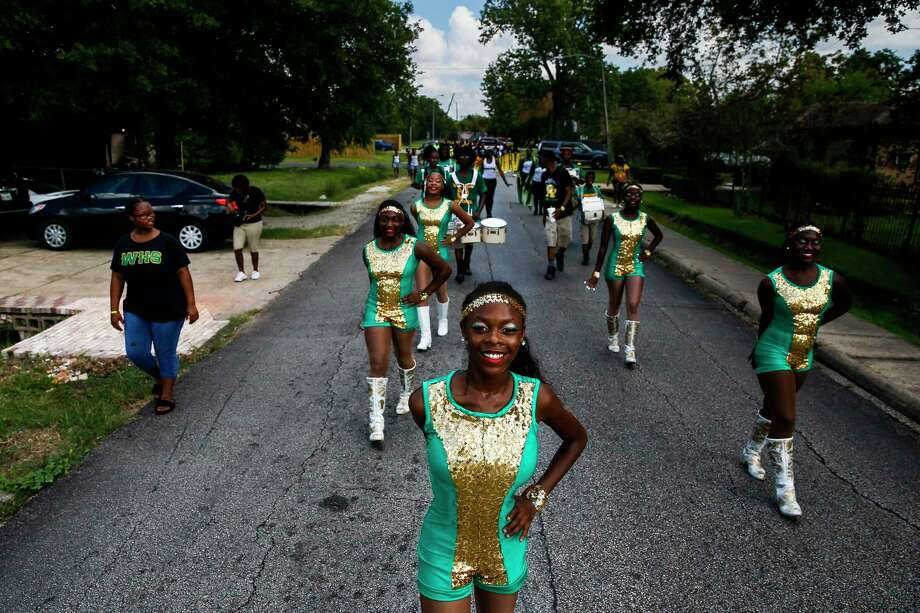 Worthing High School's Prancing Dolls perform in a parade Saturday to drum up excitement for HISD's Achieve 180 plan to help underperforming schools. Photo: Michael Ciaglo, Staff / Michael Ciaglo