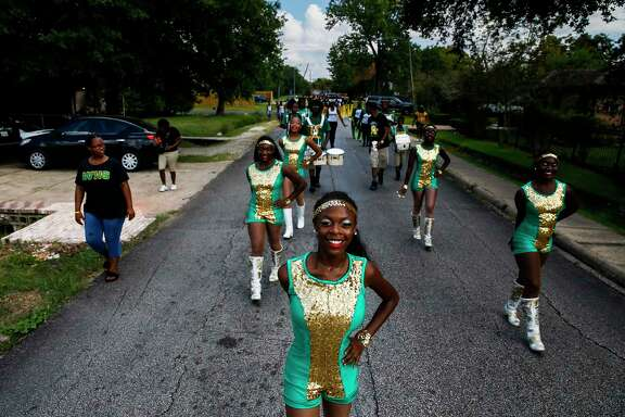 Worthing High School's Prancing Dolls perform in a parade Saturday to drum up excitement for HISD's Achieve 180 plan to help underperforming schools.