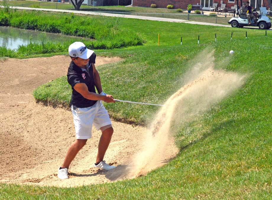 Edwardsville senior Ben Tyrrell hits a shot from a sand trap during the Quincy Invitational earlier this season. Tyrrell won the Mattoon Invitational on Saturday after shooting a 10-under par 62 on Friday.