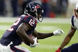 Houston Texans wide receiver Bruce Ellington (12) makes a catch in front of New England Patriots cornerback Malcolm Butler (21) during the first quarter of an NFL pre-season football game at NRG Stadium on Saturday, Aug. 19, 2017, in Houston. ( Brett Coomer / Houston Chronicle )