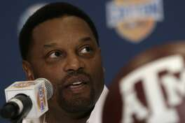 Texas A&M head coach Kevin Sumlin answers a question during a news conference leading up to the Cotton Bowl NCAA college football game Wednesday, Jan. 2, 2013, in Irving, Texas. Before Sumlin became a successful head coach, he was on Oklahoma head coach Bob Stoops  Stoops' staff. Before that, they were both assistant coaches recruiting the same area. Now Sumlin takes his Texas A&M team against Stoops' Sooners in a Jan. 4th Cotton Bowl matchup of former Big 12 rivals that are both 10-2 (AP Photo/LM Otero)