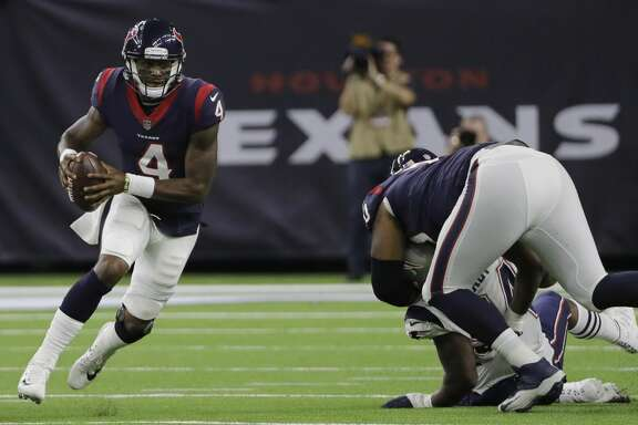 Houston Texans quarterback Deshaun Watson (4) scramble for yardage against the New England Patriots during the first half of an NFL football preseason game Saturday, Aug. 19, 2017, in Houston. (AP Photo/David J. Phillip)