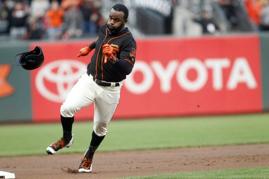 Denard Span loses his helmet as he nears third base while running out his inside-the-park home run in the first inning. Photo: Mathew Sumner, Associated Press