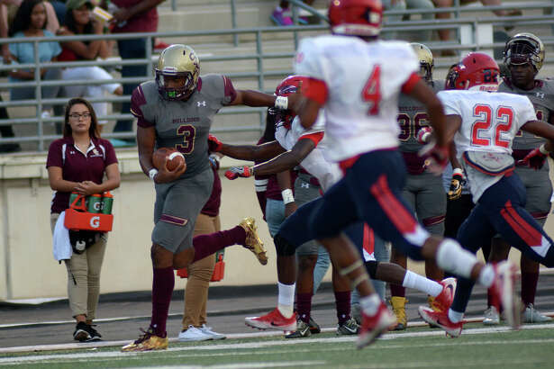 Summer Creek junior quarterback John Holcombe (3) tries to escape the Pearland Dawson defense during their matchup at Turner Stadium in Humble on Sept.  8, 2016. (Photo by Jerry Baker/Freelance)