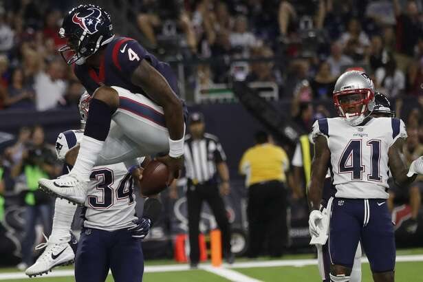 Houston Texans quarterback Deshaun Watson (4) jumps into the end zone for a touchdown during the third quarter of an NFL preseason game at NRG Stadium, Saturday, Aug. 19, 2017, in Houston.  ( Karen Warren / Houston Chronicle )