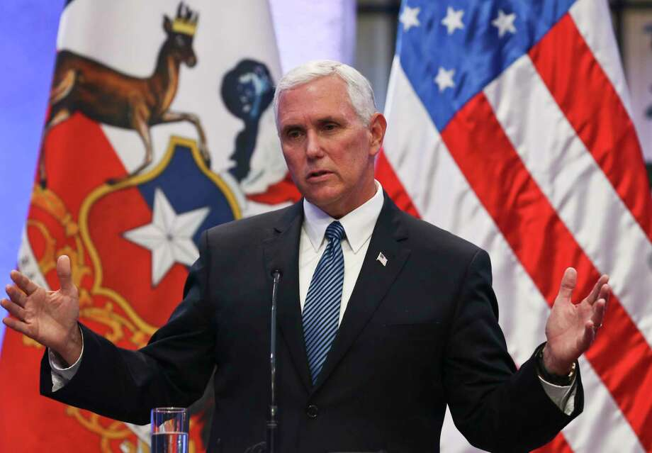 In this Aug. 16, 2017 photo, Vice President Mike Pence takes part in a joint statement with the Chilean president at La Moneda government palace, in Santiago, Chile. On Sunday, Oct. 8, Pence flew to attend an Indiana Colts football game, but then immediately left after he said he was offended by members of the opposing 49ers team taking a knee during the National Anthem.  (AP Photo/Esteban Felix) ORG XMIT: WX105 Photo: Esteban Felix / Copyright 2017 The Associated Press. All rights reserved.