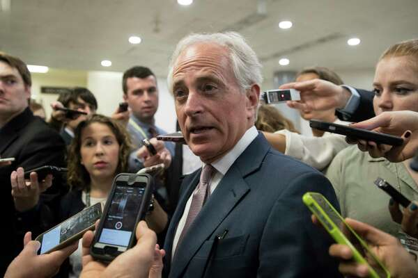 "FILE - In this July 27, 2017, Senate Foreign Relations Committee Chairman Sen. Bob Corker, R-Tenn. is surrounded by reporters on Capitol Hill in Washington.  Corker, the chairman of the Foreign Relations committee and a foreign policy ally of the Trump White House, delivered the sharpest criticism of Trump, declaring that the president ""has not yet been able to demonstrate the stability nor some of the competence that he needs to"" in dealing with crises.   (AP Photo/J. Scott Applewhite, File) ORG XMIT: WX104"