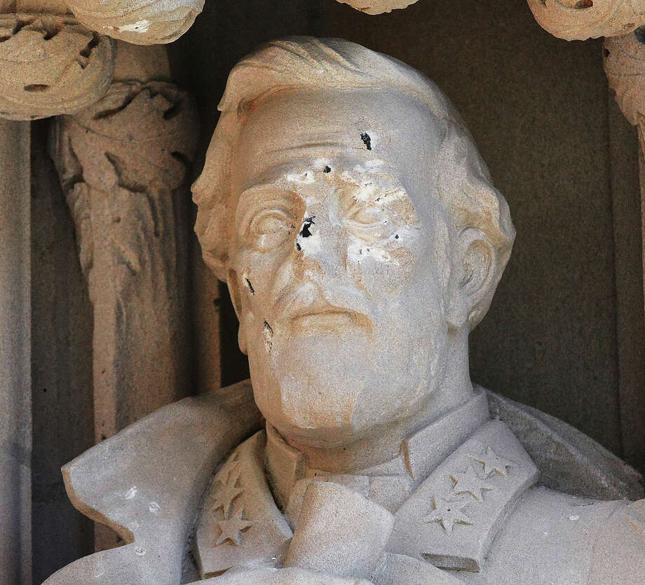 FILE - In this Aug. 17, 2017 file photo, the defaced Gen. Robert E. Lee statue stands at the Duke Chapel on Thursday, Aug. 17 2017, in Durham, N.C.  Duke University removed a statue of Gen. Robert E. Lee early Saturday, Aug. 19, days after it was vandalized amid a national debate about monuments to the Confederacy.  The university said it removed the carved limestone likeness early Saturday morning from Duke Chapel where it stood among 10 historical figures depicted in the entryway (Bernard Thomas/The Herald-Sun via AP) ORG XMIT: NCDUS201 Photo: Bernard Thomas / The Herald-Sun