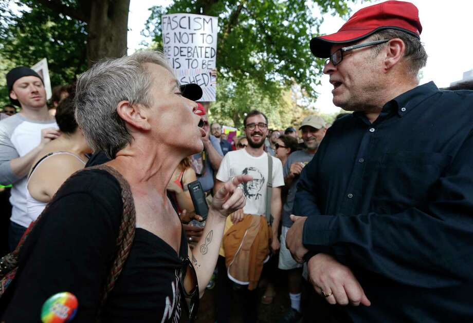 "Protesters with opposing views face off at a ""Free Speech"" rally organized by conservative activists on Boston Common, Saturday, Aug. 19, 2017, in Boston.  Thousands of demonstrators marched Saturday from the city's Roxbury neighborhood to Boston Common, where the ""Free Speech Rally"" is being held. (AP Photo/Michael Dwyer) ORG XMIT: BX112 Photo: Michael Dwyer / Copyright 2017 The Associated Press. All rights reserved."