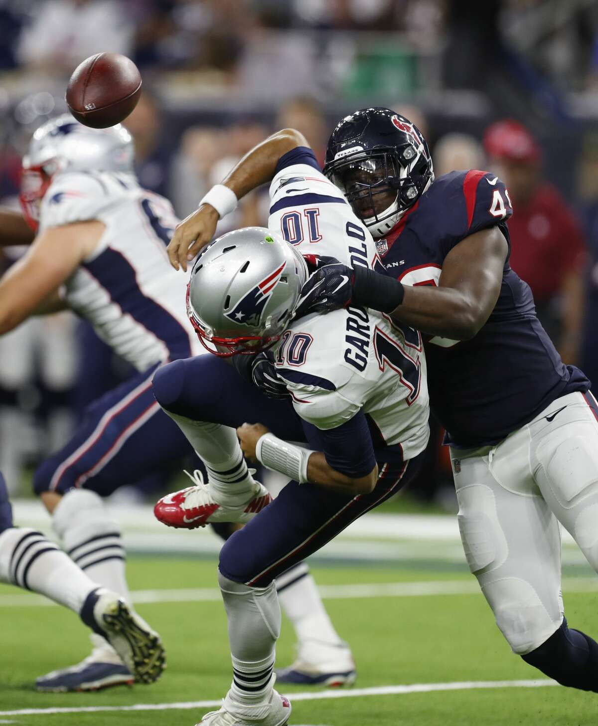 Houston Texans outside linebacker Tony Washington (49) sacks New England Patriots quarterback Jimmy Garoppolo (10) causing him to fumble the ball during the third quarter of an NFL pre-season football game at NRG Stadium on Saturday, Aug. 19, 2017, in Houston. ( Brett Coomer / Houston Chronicle )