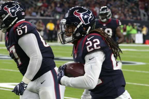 Houston Texans safety Denzel Rice (22) runs along the sidelines returning an interception of a pass by New England Patriots quarterback Jimmy Garoppolo during the fourth quarter of an NFL pre-season football game at NRG Stadium on Saturday, Aug. 19, 2017, in Houston. ( Brett Coomer / Houston Chronicle )