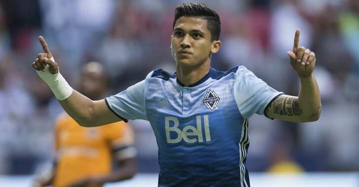 Vancouver Whitecaps' Fredy Montero celebrates after scoring on a penalty kick against the Houston Dynamo during the first half of an MLS soccer match in Vancouver, British Columbia, Saturday Aug. 19, 2017. (Darryl Dyck/The Canadian Press via AP)