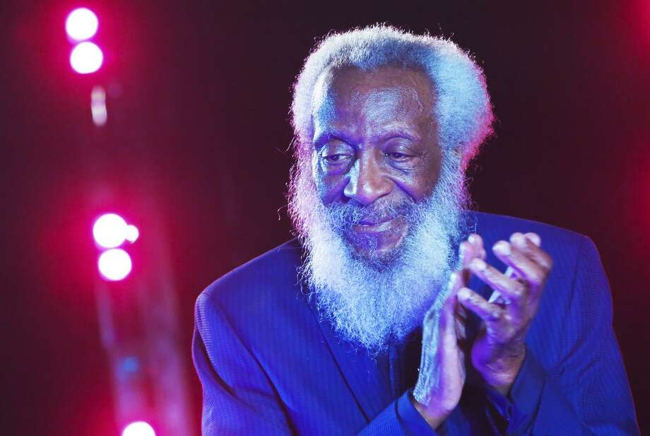 Comedian and civil rights activist Dick Gregory appears onstage in New York City in 2016. Mr. Gregory rose from an impoverished childhood in St. Louis to become a celebrated satirist. Photo: Brent N. Clarke / Brent N. Clarke / FilmMagic 2016 / 2016 Brent N. Clarke