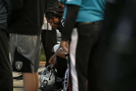 Oakland Raiders running back Marshawn Lynch (24) sits during the national anthem before the start of an NFL preseason football game between the Oakland Raiders and the Los Angeles Rams on Saturday, Aug. 19, 2017, at the Oakland Coliseum in Oakland, Calif.