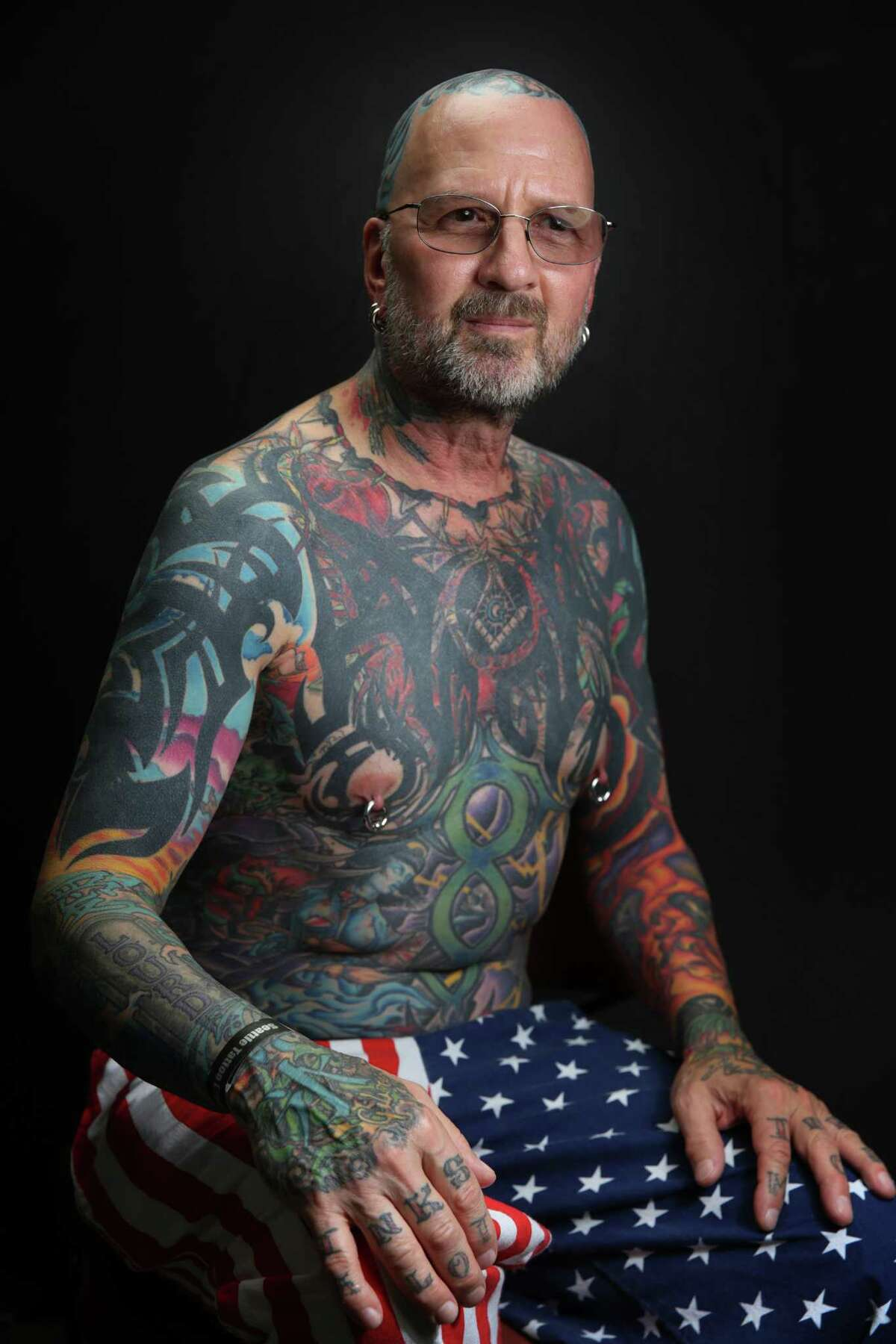Ed Scoll, who began covering his body with tattoos in 2003, poses for a portrait at the annual Seattle Tattoo Expo, Aug. 19, 2017 at Fisher Pavilion.