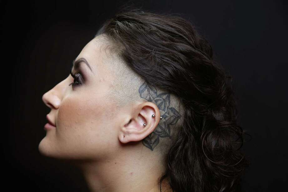 Lionella Tor-Oganova poses for a portrait at the annual Seattle Tattoo Expo, Aug. 19, 2017 at Fisher Pavilion. Tattoo artist Jerrett Spaeth did her pieces. Photo: GENNA MARTIN, SEATTLEPI.COM / SEATTLEPI.COM