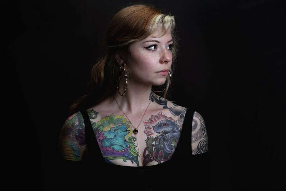 Laura Davie, a tattoo artist at Two Birds, poses for a portrait at the annual Seattle Tattoo Expo, Aug. 19, 2017 at Fisher Pavilion. Photo: GENNA MARTIN, SEATTLEPI.COM / SEATTLEPI.COM