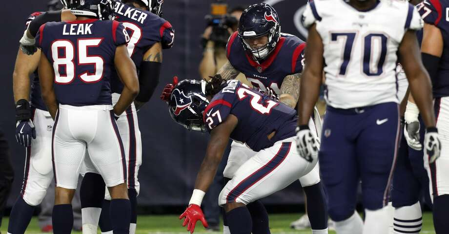 Houston Texans running back D'Onta Foreman (27) celebrates his 4-yard touchdown run against the New England Patriots during the fourth quarter of an NFL pre-season football game at NRG Stadium on Saturday, Aug. 19, 2017, in Houston. ( Brett Coomer / Houston Chronicle ) Photo: Brett Coomer/Houston Chronicle