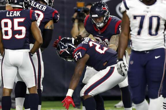 Houston Texans running back D'Onta Foreman (27) celebrates his 4-yard touchdown run against the New England Patriots during the fourth quarter of an NFL pre-season football game at NRG Stadium on Saturday, Aug. 19, 2017, in Houston. ( Brett Coomer / Houston Chronicle )