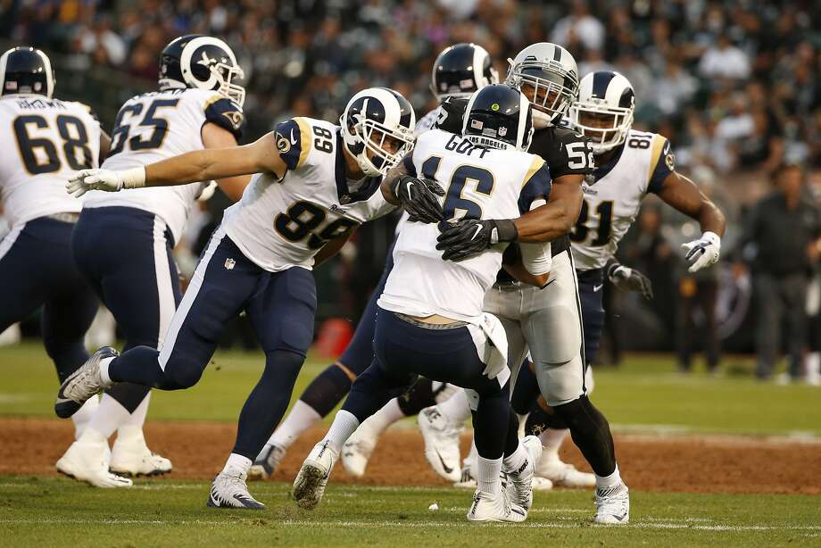 Rams quarterback Jared Goff (16) gets sacked by Raiders defensive end Khalil Mack (52) during the first half when Oakland's otherwise porous defense allowed Goff to lead two scoring drives. Photo: Santiago Mejia, The Chronicle