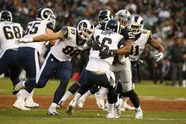 Los Angeles Rams quarterback Jared Goff (16) gets sacked by Oakland Raiders defensive end Khalil Mack (52) during the first half of an NFL preseason football game between the Oakland Raiders and the Los Angeles Rams on Saturday, Aug. 19, 2017, at the Oakland Coliseum in Oakland, Calif.