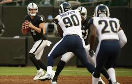 Raiders quarterback Derek Carr (4) threw two touchdown passes and finished 7 of 9 for 100 yards in Saturday night's preseason game at the Oakland Coliseum.