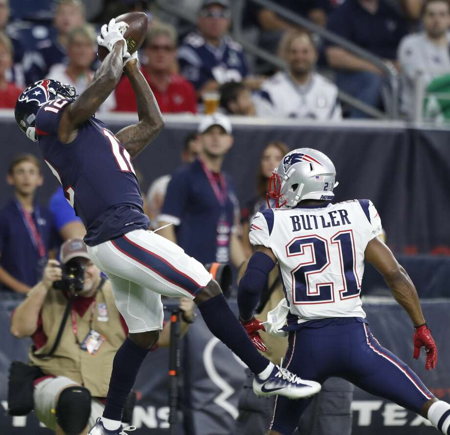 Houston Texans wide receiver Bruce Ellington (12) leaps over New England Patriots cornerback Malcolm Butler (21) for a 37-yard reception during the first quarter of an NFL preseason game at NRG Stadium, Saturday, Aug. 19, 2017, in Houston.  ( Karen Warren / Houston Chronicle ) Photo: Karen Warren/Houston Chronicle