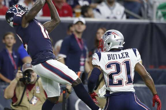 Houston Texans wide receiver Bruce Ellington (12) leaps over New England Patriots cornerback Malcolm Butler (21) for a 37-yard reception during the first quarter of an NFL preseason game at NRG Stadium, Saturday, Aug. 19, 2017, in Houston.  ( Karen Warren / Houston Chronicle )